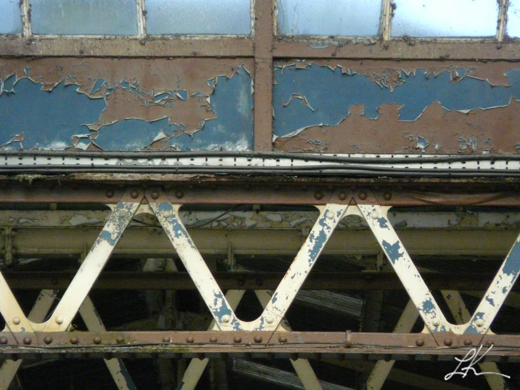 Photo: Paint chipping on rail station.