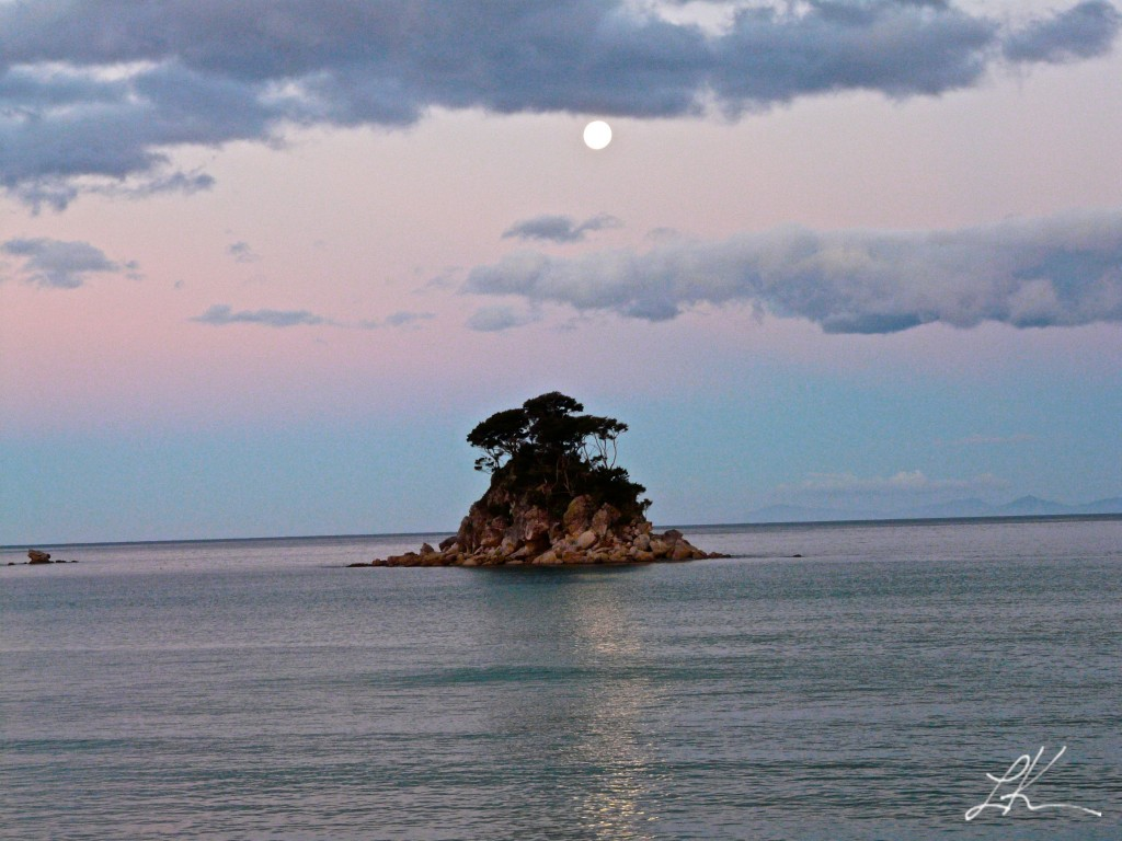 Photo: Small island in sea inlet.