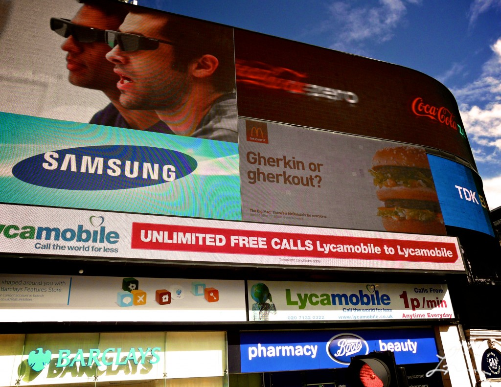 Photo: Advertisement Screen on a Busy London Street.