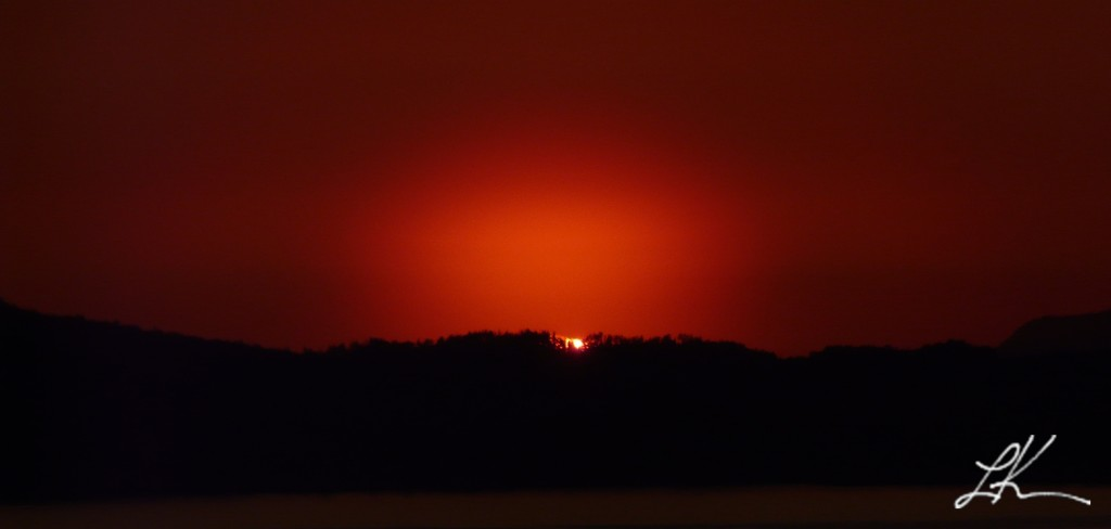 Photo: Glowing Red Sunset Over Mountain.