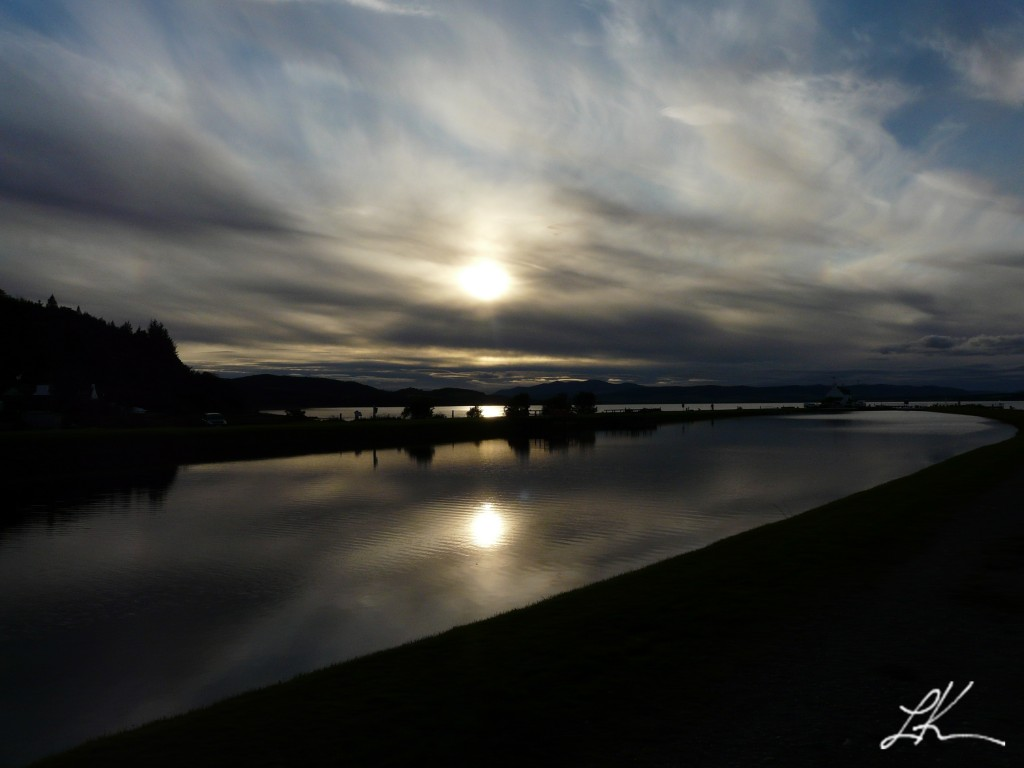 Photo: Setting Sun Reflecting on Lake.