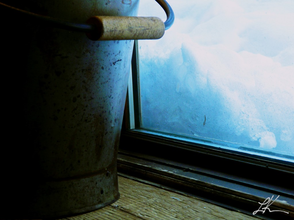 Photo: Snow Pack Against a Cabin Window.